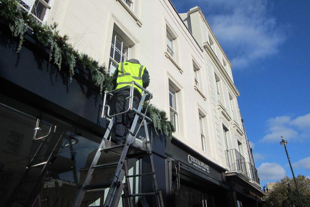 Installation of retail shop exterior decor