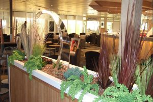 display of grasses and fern in cruise ship restaurant