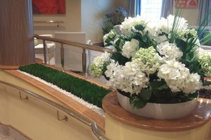 Artificial grass and Silk flower display on a cruise ship
